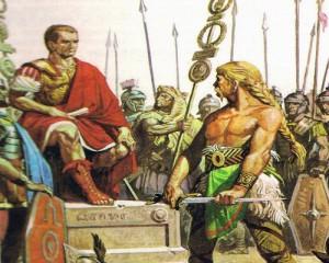 Побежденный Верцингеториг снимает оружие и бросает его к ногам Цезаря.